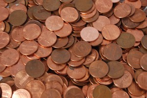 Man Pays Off Mortgage With Pennies, Takes Tellers Two Days To Unroll Cases