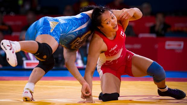 Canada's Carol Huynh (red) takes on Japan's Hitomi Obara (blue) in the women's freestyle 48 kg semi-final at the 2012 Summer Olympics in London, England, Wednesday August 8/2012. Huynh lost the match 3-1