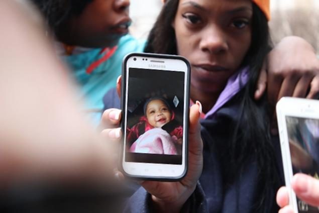 DNAINFO.COM CHICAGO Dominique Young, the aunt of 6-month-old Johnylah Watkins, shows a photo of her niece, who was shot while her father, Jonathan Watkins, changed her diaper.