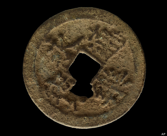 This Feb. 8, 2013 provided by The Field Museum in Chicago shows a rare, 600-year-old Chinese coin that scientists from Illinois discovered on the Kenyan island of Manda. The museum announced the discovery Wednesday, March 13, 2013, The coin is made of copper and silver and has a square hole in the center so it could be worn on a belt. Scientists say it was issued by Emperor Yongle of China who reigned from 1403-1425 during the Ming Dynasty. (AP Photo/Courtesy The Field Museum, John Weinstein)