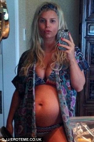 Jessica Simpson flaunts big baby bump in Twitter photo