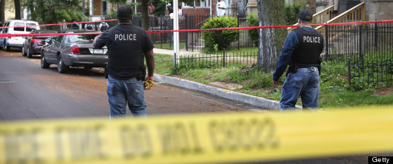CHICAGO, IL - JUNE 10: Police investigate the scene where five people were shot in a drive-by shooting on June 10, 2013 in Chicago, Illinois. One of the five, Eighteen-year-old April McDaniel died at the hospital from her wounds.The five were among at least 12 people reported to have been shot today in Chicago. (Photo by Scott Olson/Getty Images)