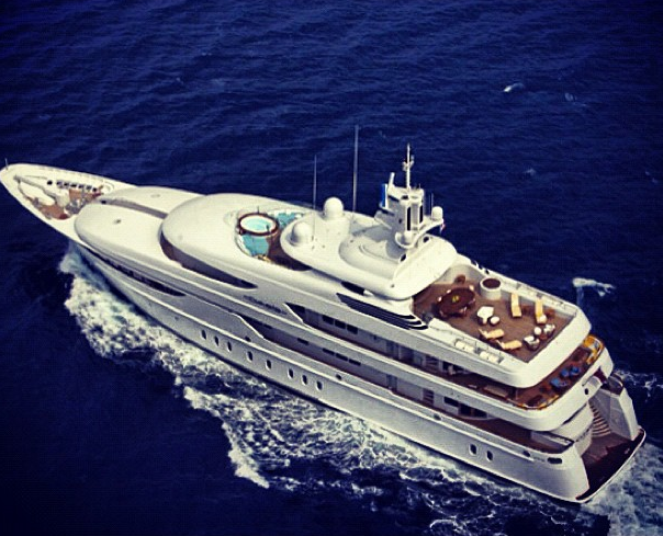The yacht includes a top-deck party floor with bar, stage and projector screen. The living area features creamy leather sofas accented with pillows. Giant jars of dried apricots adorn the mantelpieces and books about Africa are displayed on tables.  Each deck comes with a private quarter behind sliding doors. Electric blue lights beam, greeting those guests invited inside. In one secluded space, Diddy's emperor size bed is decorated with monogrammed pillows.