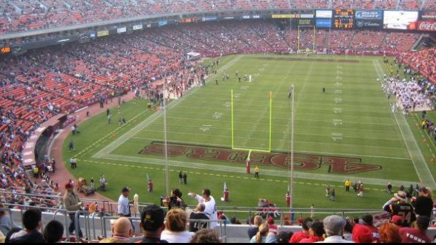 A football fan fell to his death from an elevated pedestrian walkway Sunday at Candlestick Park during the 49ers' final season opener at the San Francisco stadium, police said.