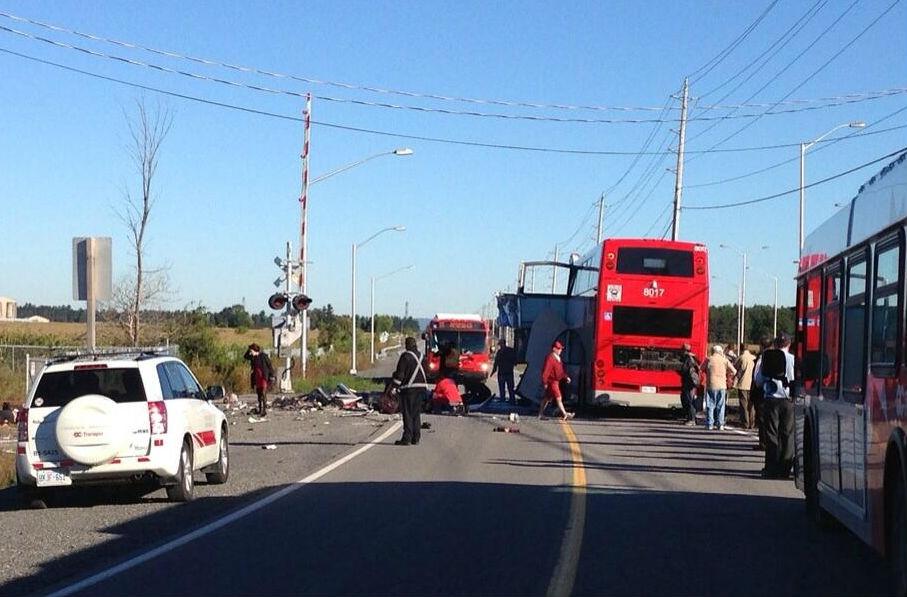 At least 5 dead in Ottawa city bus, Via train crash