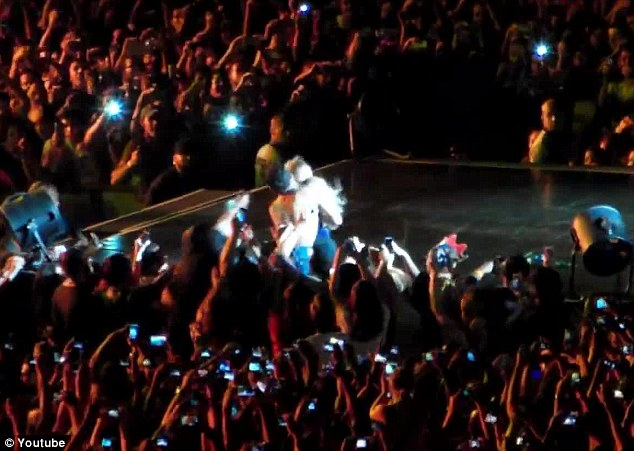 Unscripted exit: A fan in Sao Paulo, Brazil pulled singer Beyonce off the stage on Sunday night while she was performing in her Mrs. Carter show