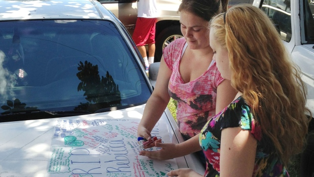 In this Sept. 10, 2013 photo, Summer Howard, 19 and Alecia Wilkins, 18, make a poster for Summer's sister Rebecca Sedwick. Polk County Sheriff Grady Judd said that Sedwick jumped to her death on Sept. 9, 2013, at an old cement business in Lakeland, Fla. (AP / The Lakeland Ledger, Stephanie Allen)