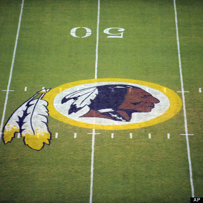 FILE - This Aug. 28, 2009 file photo shows the Washington Redskins logo on the field before  he start of a preseason NFL football game in Landover, Md. he team's nickname, which some consider a derogatory term for Native Americans, has faced a barrage of criticism. Local leaders and pundits have called for a name change. Opponents have launched a legal challenge intended to deny the team federal trademark protection. A bill introduced in Congress in March would do the same, though it appears unlikely to pass. But a new Associated Press-GfK poll shows that nationally, ?Redskins? still enjoys widespread support. (AP Photo/Nick Wass, File)