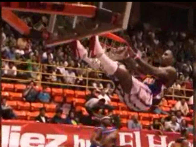"""A dunk ended with a close call recently for a Harlem Globetrotters basketball player William """"Bull"""" Bullard. Photographer: Harlem Globetrotters via CNN"""