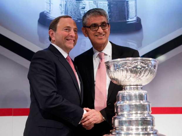 Blockbuster: NHL Commissioner Gary Bettman, left, and Nadir Mohamed, President and CEO of Rogers Communications