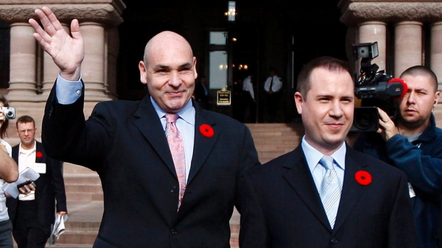 George Smitherman, left, released a statement saying his husband, Christopher Peloso, was found dead by Toronto police. (Nathan Denette/Canadian Press)