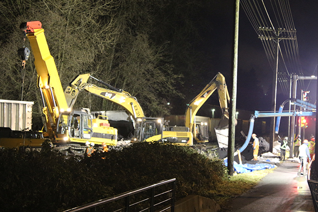 Burnaby resident Robert Finlay took this picture Saturday night of the cleanup effort at the site of the CP train derailment. Photograph by: Robert Finlay , Supplied