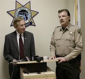 Monterey County District attorney Dean Flippo, left, and Monterey County Sheriff Scott Miller answer questions during a news conference, Tuesday, Feb. 25, 2014, in Salinas, Calif. Flippo said the six officers, including the recently retired police chief and the acting chief, have been arrested, in connection to a scheme to steal more than 200 cars from poor Hispanic people. (AP Photo/The Monterey County Herald, Vern Fisher) AP PHOTO/THE MONTEREY COUNTY HERALD, VERN FISHER