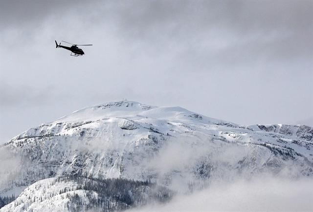A search and rescue helicopter heads to an avalanche site near Revelstoke, B.C. in a 2010 file photo. THE CANADIAN PRESS/Jeff McIntosh