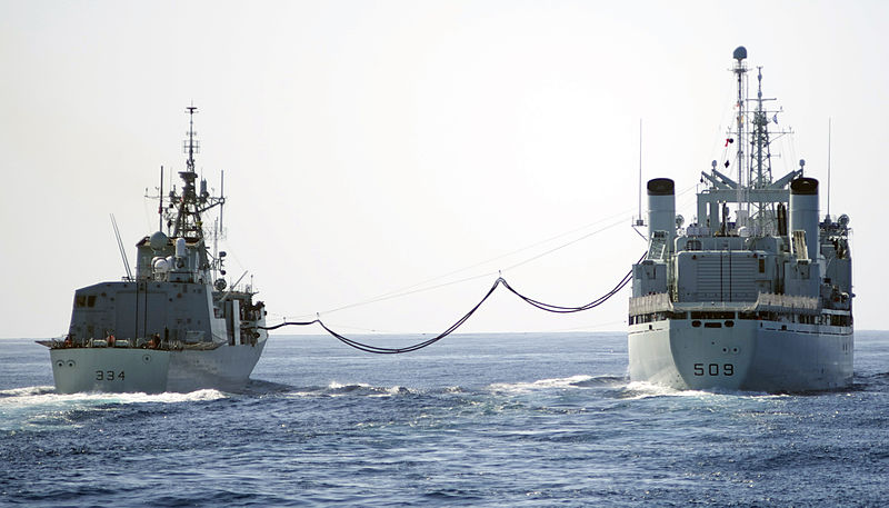 PACIFIC OCEAN (Oct. 10, 2013) The Canadian Halifax-class frigate HMCS Regina conducts an underway replenishment with the Canadian Protecteur-class auxiliary oiler replenishment ship HMCS Protecteur during a training exercise. The exercise trains independent deployers in air defense, anti-submarine and anti-surface warfare and maritime interdiction operations, while also building a strong working relationship between the maritime and aviation forces of the U.S. and Canada.