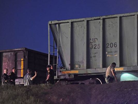 Law enforcement investigates the scene where two teens were hit by a freight train Friday, March 21, 2014. A teen boy was pronounced dead at the scene. A teen girl suffered serious injuries. (Photo: Chris Kaufman/Appeal-Democrat)