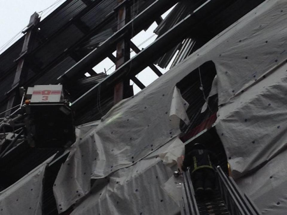 "BOSTON FIRE DEPARTMENT Fire officials said at the scene, which is on the edge of the Chinatown district, that a ""dead load"" fell from the 12th floor, the highest level the project had reached so far, to the fifth floor."