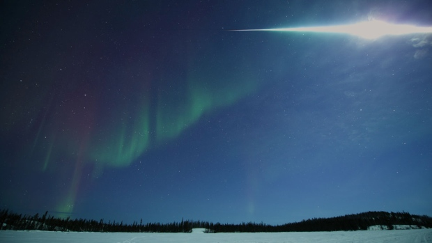 Yuichi Takasaka took this photograph of a fireball exploding in the skies over Yellowknife at around 2 a.m. MT Thursday from Vee Lake during an aurora viewing tour. (Yuichi Takasaka)