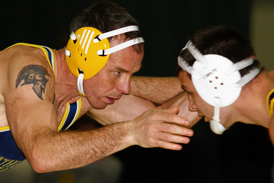 Rick Chipman, left, won 32 matches and lost 46 as a 40-something wrestler at Southern Maine. Jason Johns/University of Southern Maine