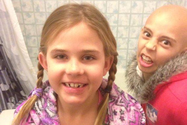 School suspends girl who shaved head to support cancer-stricken friend