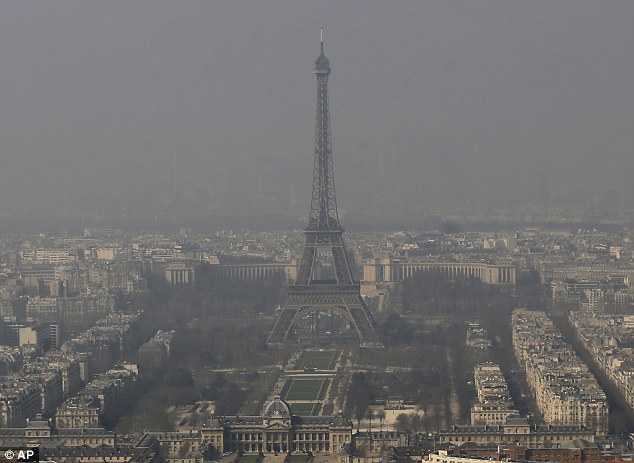 The Eiffel Tower, is barely seen through the smog from Paris. Drivers in Paris will only be allowed to use their cars every other day from tomorrow because of dangerous pollution levels   Read more: http://www.dailymail.co.uk/news/article-2582073/Air-pollution-Paris-gets-bad-car-driving-BANNED-alternate-days.html#ixzz2wEVGELbd  Follow us: @MailOnline on Twitter | DailyMail on Facebook