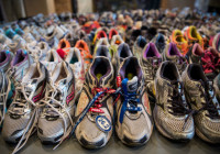 Runner's shoes are laid out in a display titled, `Dear Boston: Messages from the Marathon Memorial' in the Boston Public Library, on April 14, 2014 in Boston, Massachusetts. AFP