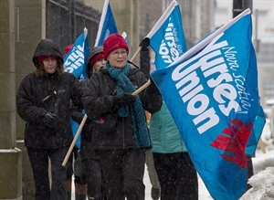 Nurses protest against the introduction of the Essential Health and Community Services Act outside the legislature in Halifax on Tuesday, April 1, 2014. The legislation would require unions and employers throughout the health-care sector to have an essential services agreement in place before strikes or lockouts start. THE CANADIAN PRESS/Andrew Vaughan THE CANADIAN PRESS/ANDREW VAUGHAN