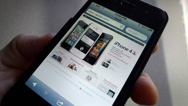 Both alleged iPhone 6 screens will be larger than the 4.0-inch panels on Apple's existing iPhone 5S and 5C models. (Graeme Roy/Graeme Roy/THE CANADIAN PRESS)