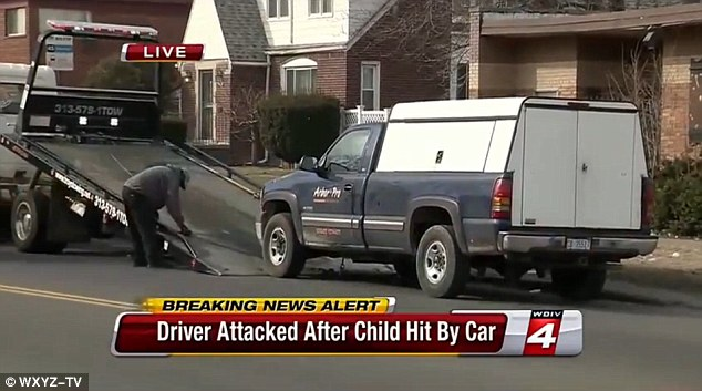 Brutal beatdown: The unidentified driver was savagely beaten after stopping to check on the young boy he accidentally hit with while driving this pickup truck