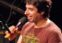 Penmachine - Own work Jian Ghomeshi hosting a live taping of his radio show Q in Vancouver, 26 Mar 2009