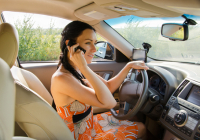 © Ampack | Dreamstime.com - Woman Driver Talking On Her Mobile Photo