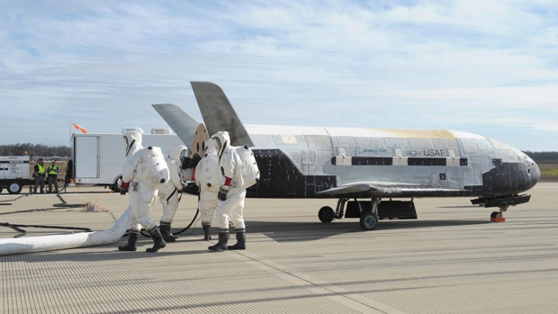 Some experts have said that the X-37B Orbital space plane carried a payload of spy gear in its cargo bay or, was shadowing China's space lab. (Boeing/ Reuters)
