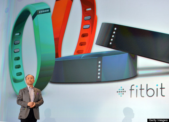 """Softbank president Masayoshi Son announces the launch of the new health care service using wristband styled devices """"Fitbit Flex"""" and smartphones in Tokyo on May 7, 2013. The Fitbit Flex monitors data through a pedometer, calorie consumption and hours of sleep and transfers the information to a smartphone to maintain the user's health. Softbank is expecting to start the service from this summer.   AFP PHOTO / Yoshikazu TSUNO        (Photo credit should read YOSHIKAZU TSUNO/AFP/Getty Images)"""