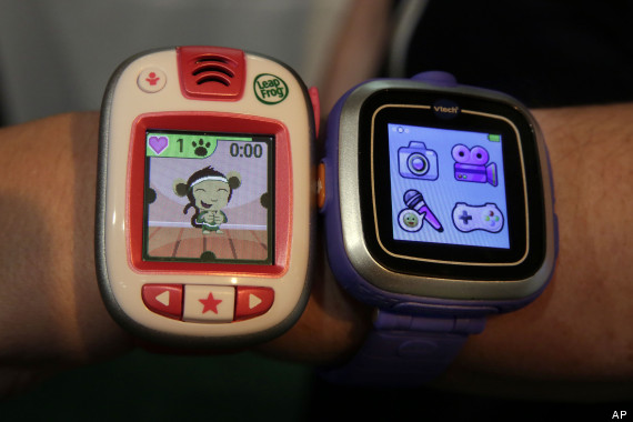 A LeapBand, left, from LeapFrog, and a Kidizoom Smartwatch, from VTech, are displayed at the TTPM Holiday Showcase, in New York, Wednesday, Oct. 1, 2014. (AP Photo/Richard Drew)