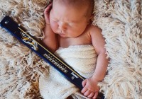 He shoots, he scores: Carrie Underwood posted a photo of four-week-old son Isaiah Michael Fisher holding a hockey stick representing his professional athlete father