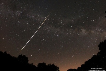 Skywatcher and photographer Brian Emfinger captured this magnificent Lyrid fireball with the Milky Way in the background from Ozark, Ark., during the April 21-22 peak of the 2012 Lyrid meteor shower. CREDIT: Brian Emfinger