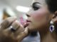 PATTAYA, THAILAND - MAY 02:  Contestants apply makeup backstage before the Miss Tiffany's Universe transgender beauty contest on May 2, 2014 in Pattaya, Thailand.  The Miss Tiffany's Universe contest has taken place annually in Pattaya since 2004 and is broadcast live on Thai national television. (Photo by Taylor Weidman/Getty Images)